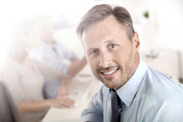 WPH-www-Business-manager-with-employees-in-background